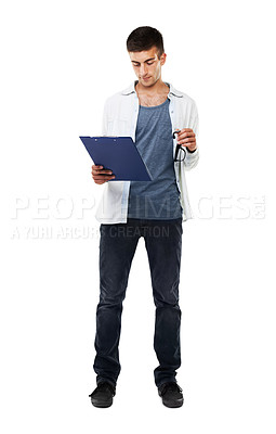 Buy stock photo A full length image of a male looking at a clipboard