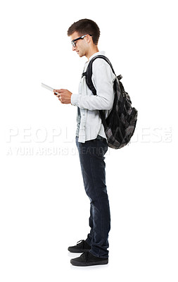 Buy stock photo Full length shot of a young man holding a digital tablet isolated on white