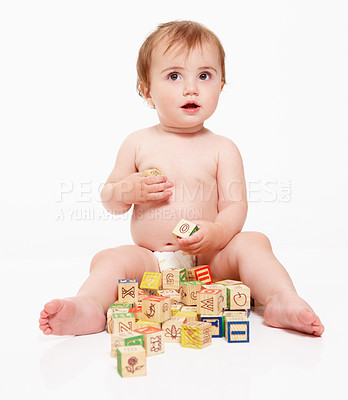 Buy stock photo Studio shot of a young baby playing with building blocks isolated on white