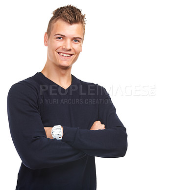 Buy stock photo Studio portrait of a smiling young guy standing with his arms folded against a white background