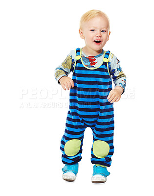 Buy stock photo Cute little baby boy standing against a white background