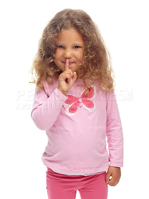 """Buy stock photo Cute little girl making a """"ssh"""" gesture against a white background"""
