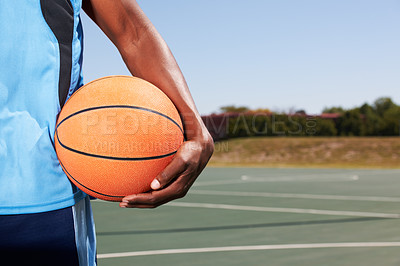 Buy stock photo A sideview of an arm holding a basketball