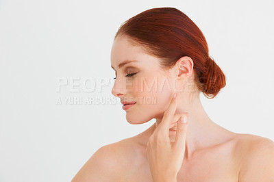 Buy stock photo Profile of a woman touching her face