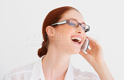 Buy stock photo A young woman talking and laughing on the phone
