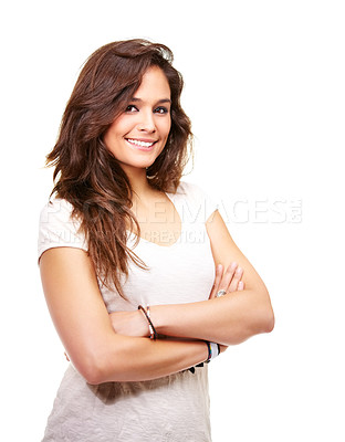 Buy stock photo Studio shot of a beautiful young woman standing with her arms folded