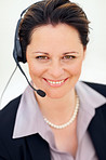 Closeup portrait of a happy business woman using a headset