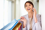 Young woman enjoying a conversation on the phone while shopping