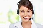 Pretty young female wearing a headset , call centre