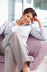 Pretty business woman sitting comfortably on a chair