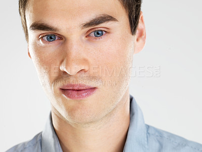 Buy stock photo Portrait of handsome young man smiling against white background