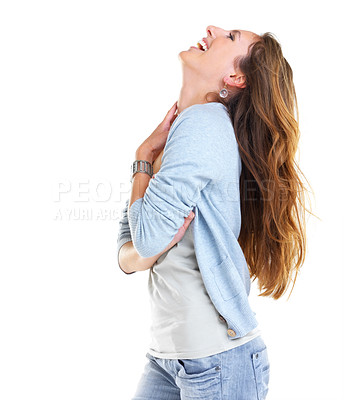 Buy stock photo Portrait of a happy young female laughing against white background