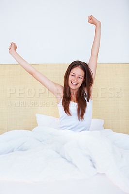 Buy stock photo A gorgeous young woman stretching out after a night's sleep