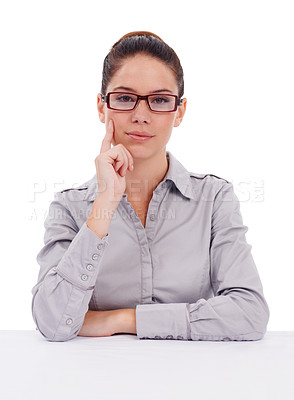Buy stock photo Studio portrait of a stern-looking young businesswoman wearing glasses isolated on white