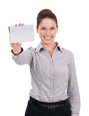 Buy stock photo Studio portrait of an attractive young woman holding up a small blank sign isolated on white