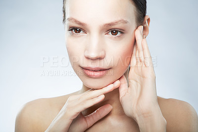 Buy stock photo Head and shoulder portrait of a beautiful young woman in the nude posing with hands on her face