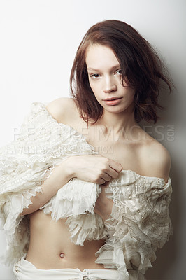 Buy stock photo Portrait of a beautiful young woman semi-clad with a lace shawl wrapped around her
