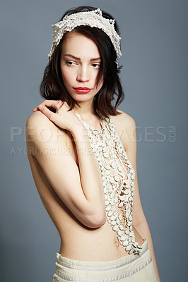Buy stock photo A beautiful young woman posing semi-clad in vintage clothing