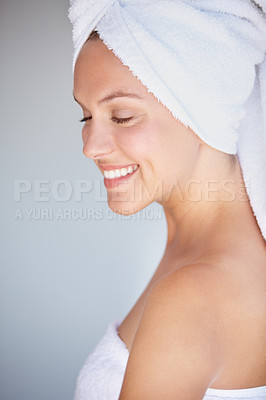 Buy stock photo Shot of a beautiful young woman with a towel wrapped around her hair
