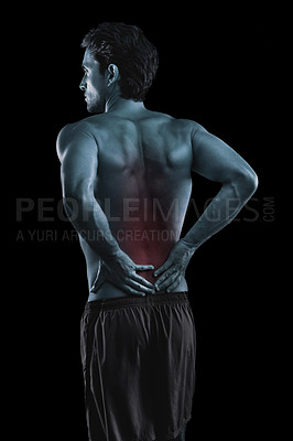 Buy stock photo Muscular young man with lower back pain