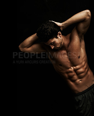 Buy stock photo Well built young man with well defined abs - Isolated on black