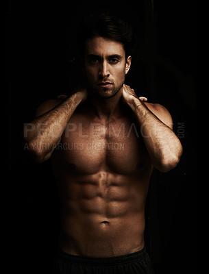 Buy stock photo Portrait of a handsome young man showing off his six pack - Isolated on black