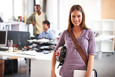 Buy stock photo A pretty young businesswoman arriving at work after commuting by bike