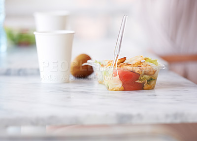 Buy stock photo A salad and paper cup standing on a counter