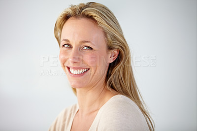 Buy stock photo Portrait of a beautiful businesswoman sitting in the office