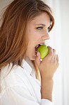 Biting into a juicy green apple