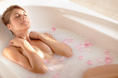 Buy stock photo An attractive young woman taking a relaxing bath
