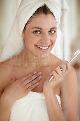 Buy stock photo An attractive young woman brushing her teeth