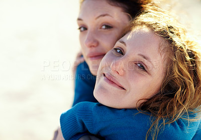 Buy stock photo Closeup portrait of two siblings embracing warmly while sitting outside