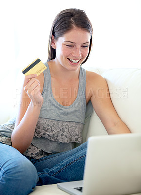 Buy stock photo A beautiful young woman doing online shopping with her credit card