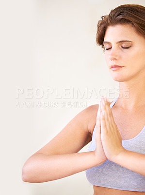 Buy stock photo Closeup of a beautiful woman meditating with her palms together
