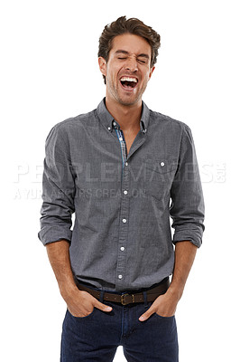 Buy stock photo A handsome young man laughing with his hands in his pockets