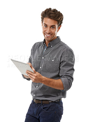 Buy stock photo Portrait of a handsome young man working on his digital tablet