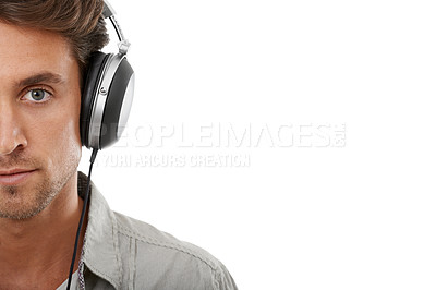 Buy stock photo Cropped portrait of a handsome young man listening to music