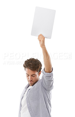 Buy stock photo A handsome young man holding up a sign for your copyspace