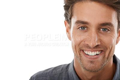 Buy stock photo Portrait of a handsome young man smiling against a white background