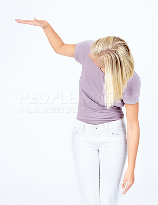Buy stock photo Young woman gesturing something short besides her