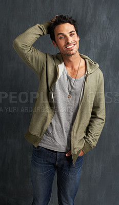 Buy stock photo Portrait of a handsome young man scratching his head while smiling