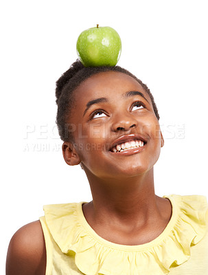 Buy stock photo Studio shot of a young african american girl balancing an apple on her head isolated on white