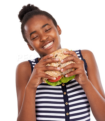 Buy stock photo Shot of a happy young african american girl holding a salad sandwich isolated on white