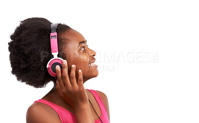 Buy stock photo Studio shot of a young african american girl listening to music on headphones isolated on white