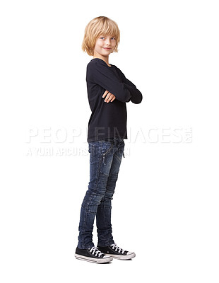 Buy stock photo Portrait of a pretty little girl standing with arms crossed and smiling against a white background