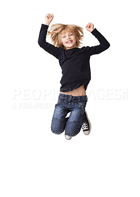 Buy stock photo Portrait of a pretty little girl smiling and jumping with arms raised in the air against a white background