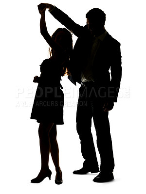 Buy stock photo Portrait of a sweet young couple dancing together against white background