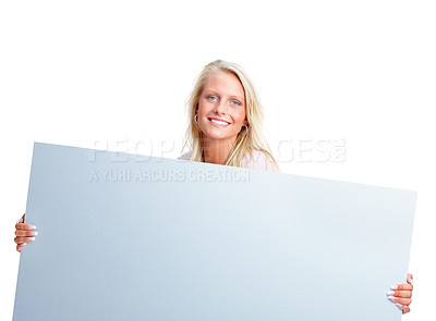 Buy stock photo Portrait of a beautiful young woman holding an empty billboard over white background