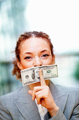 Buy stock photo Young African American business woman been bribed to keep silent